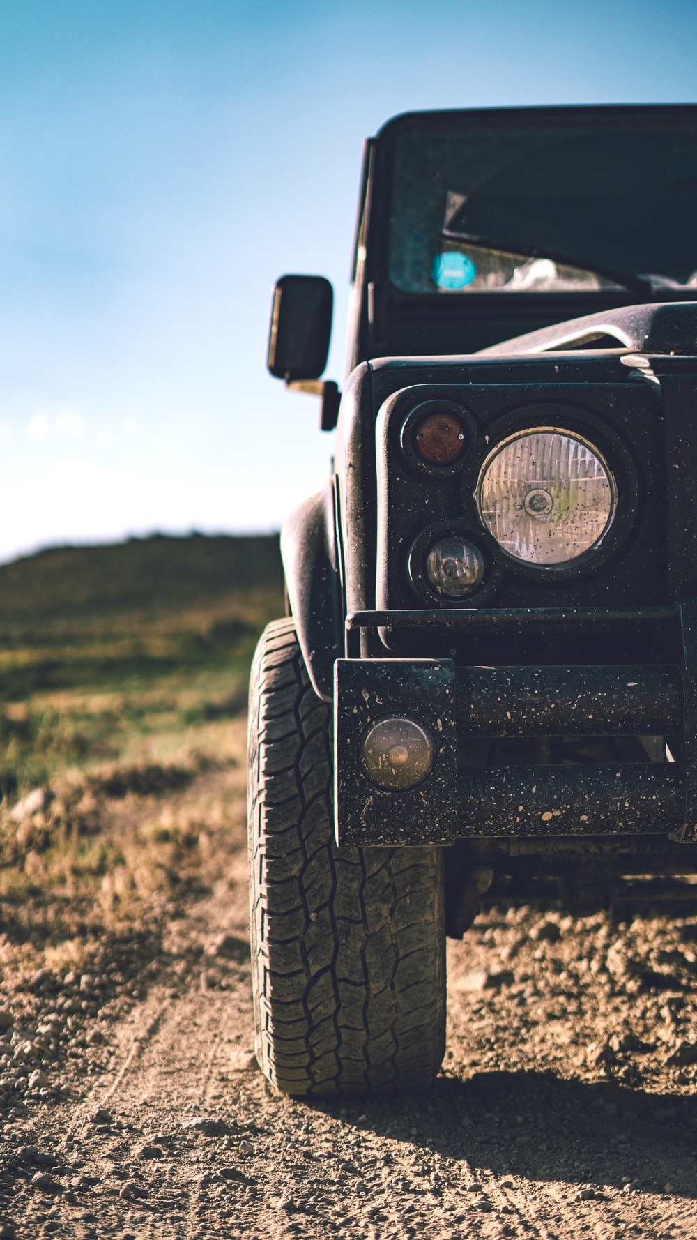 black jeep wrangler on green grass field during daytime
