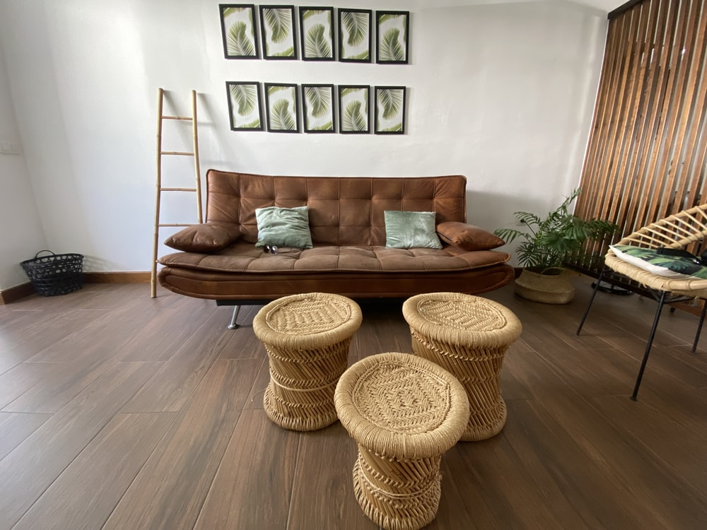 brown wicker round basket on brown wooden table