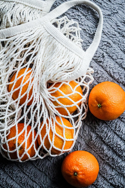orange fruits on gray knit textile