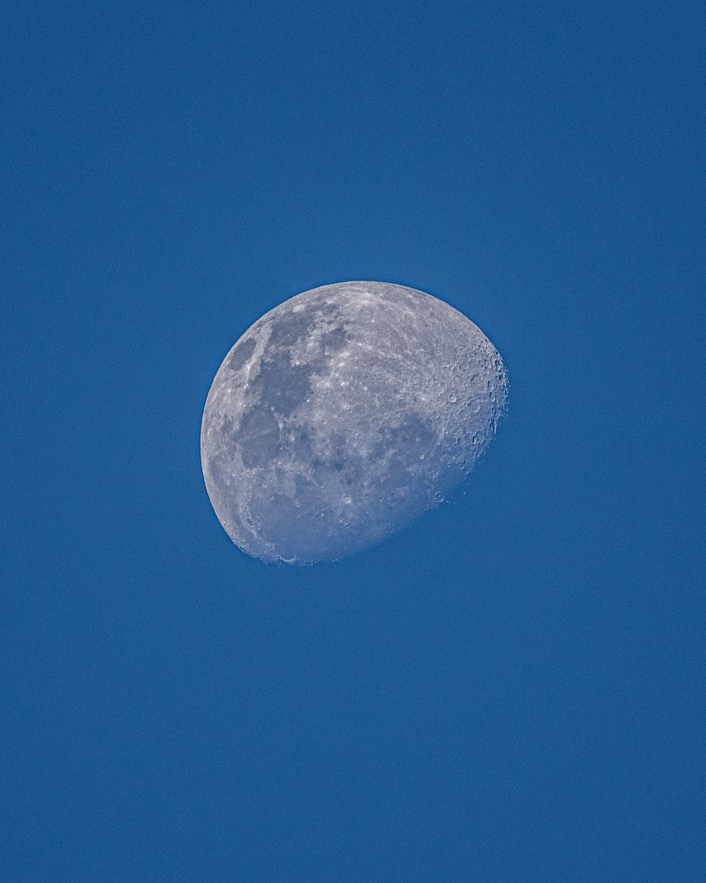 full moon in blue sky