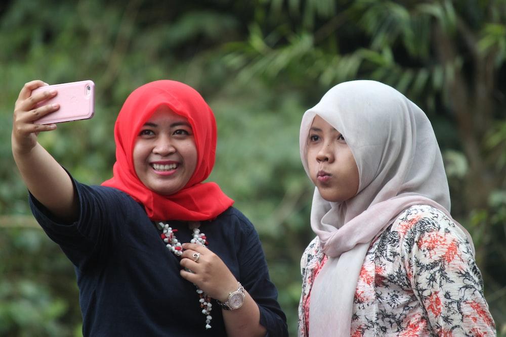 woman in white hijab and black hijab