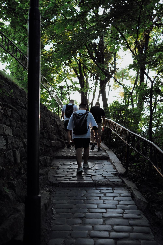 2 men walking on stairs
