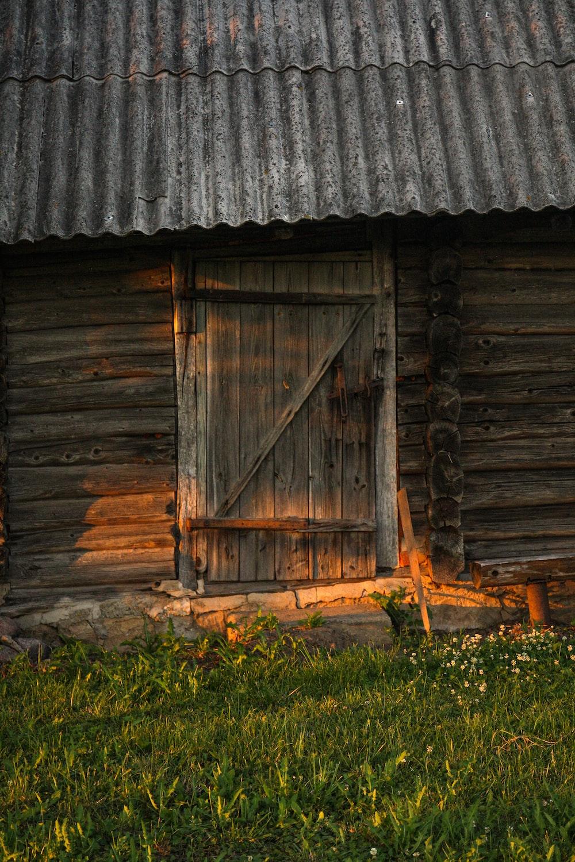 brown wooden door on gray wooden wall