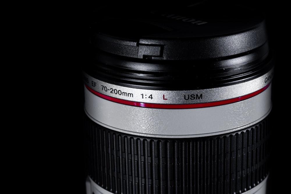 black camera lens on white background