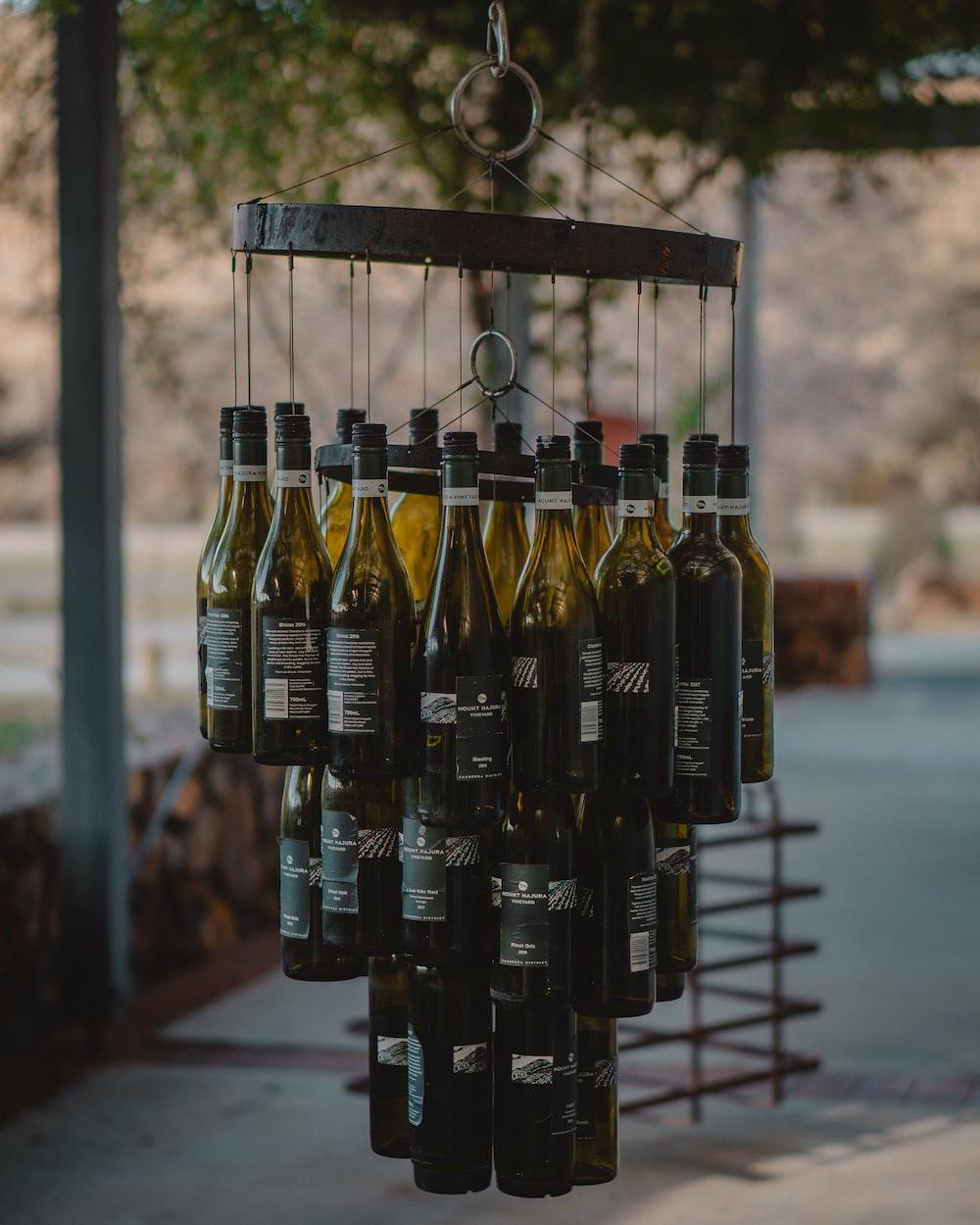 black and gold bottles on black metal rack