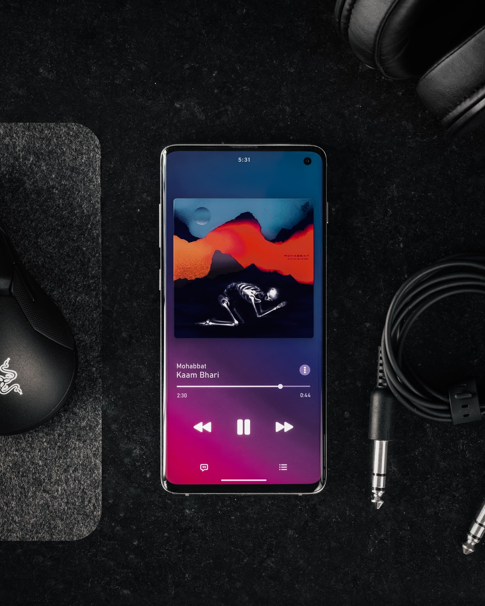 black android smartphone beside black corded computer mouse