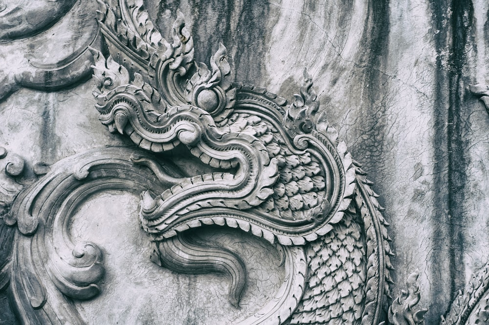 gray concrete wall with dragon embossed