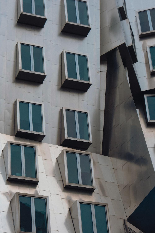white concrete building with blue windows