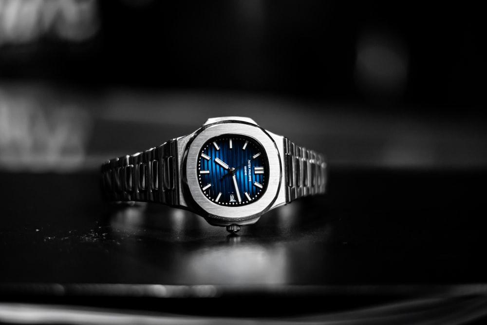 silver and blue analog watch