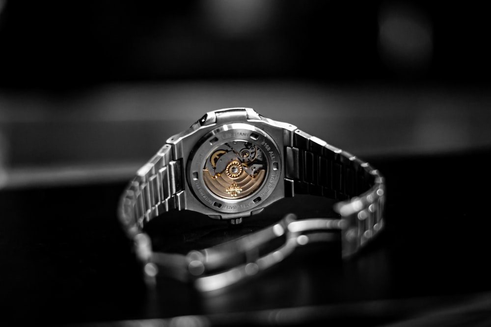 silver and black digital watch