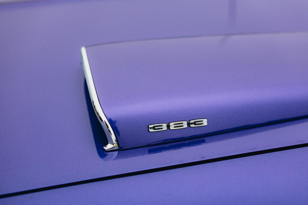 blue mercedes benz car on purple background