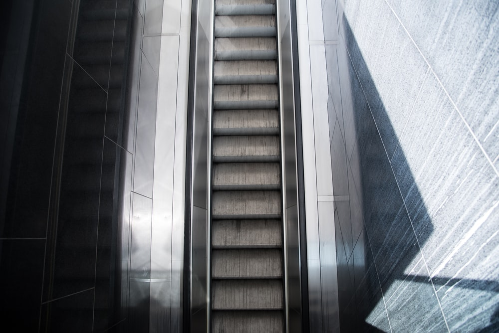 gray and brown concrete staircase