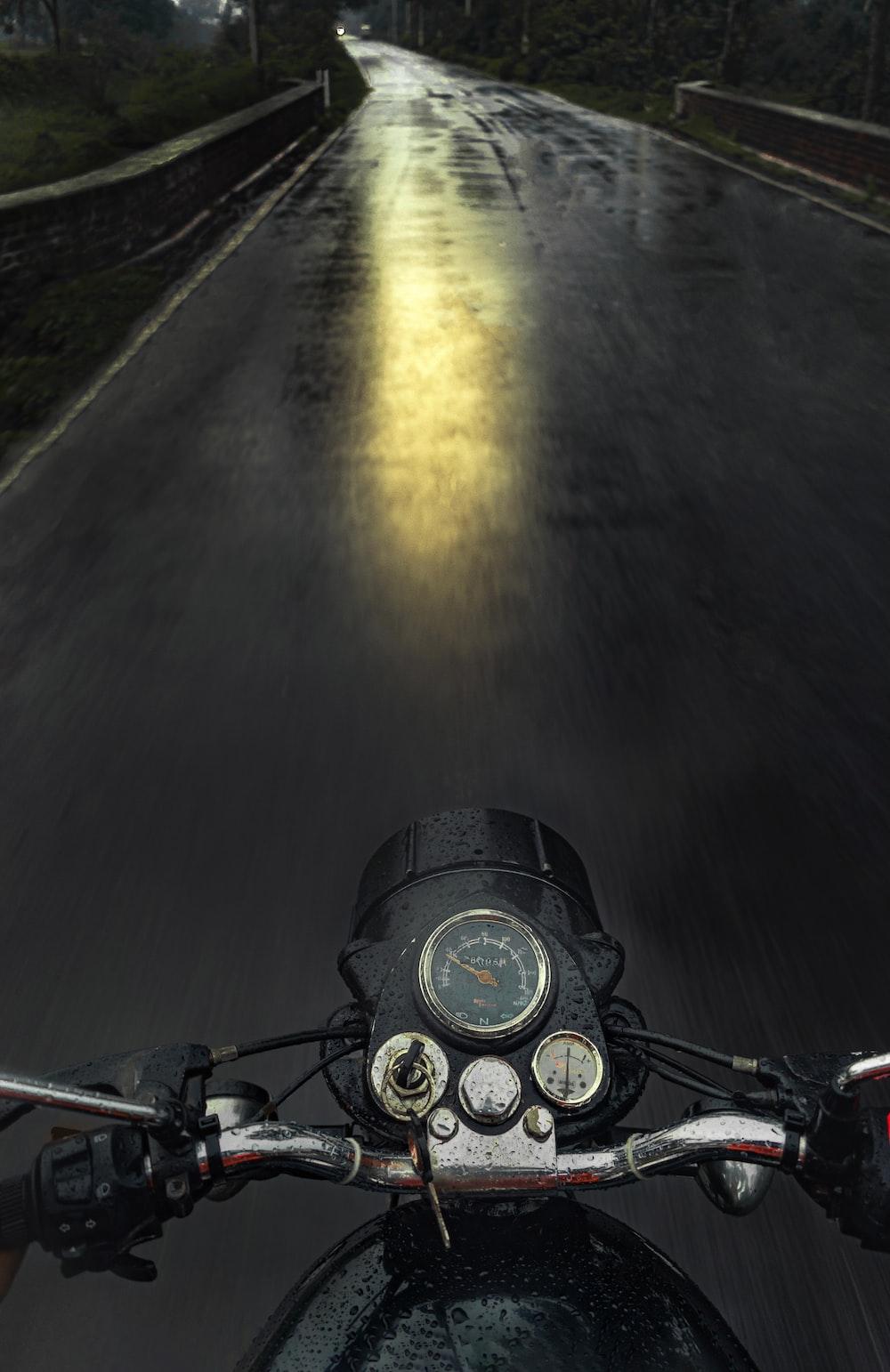 black motorcycle on road during daytime