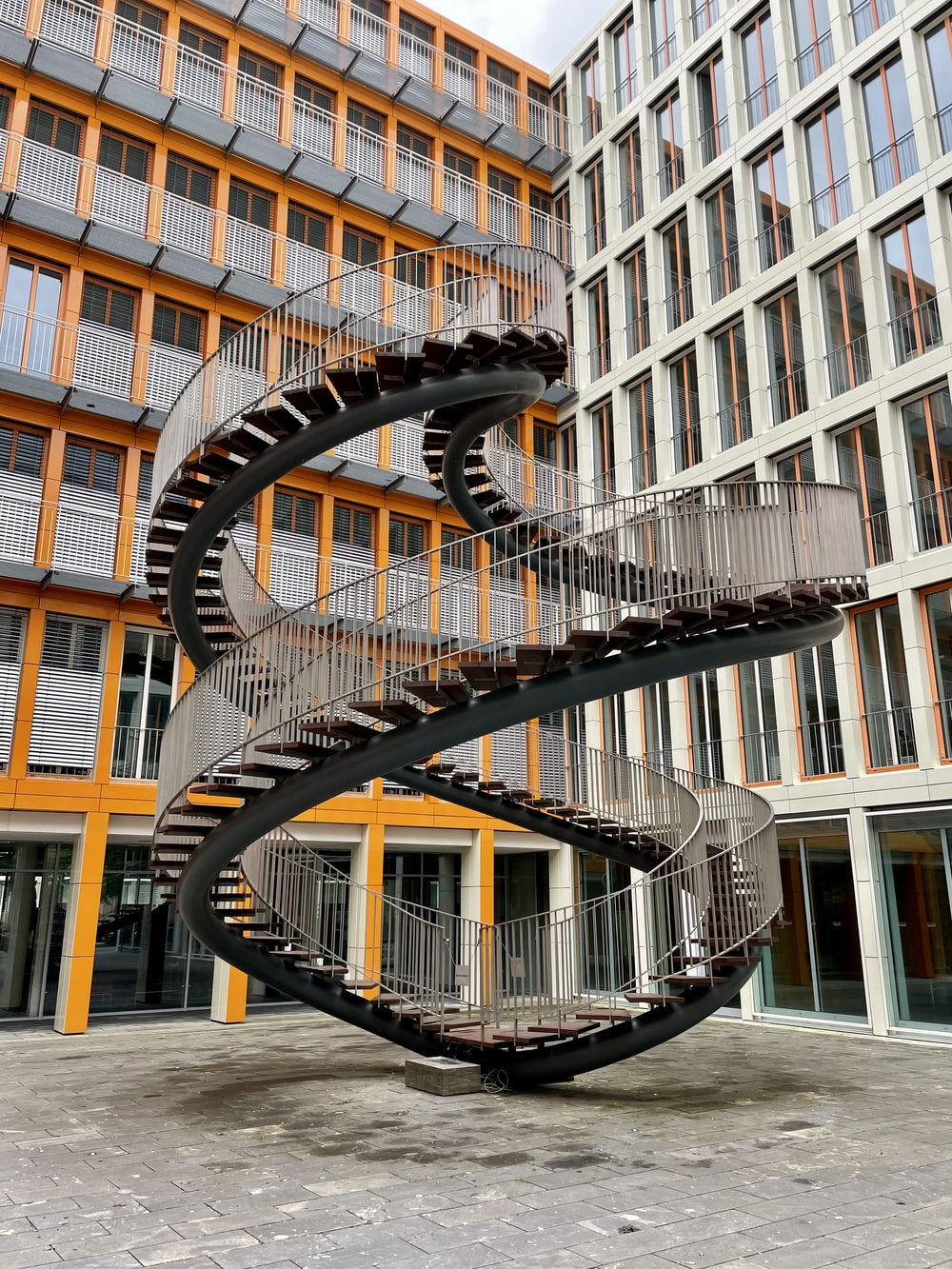 yellow spiral staircase in building
