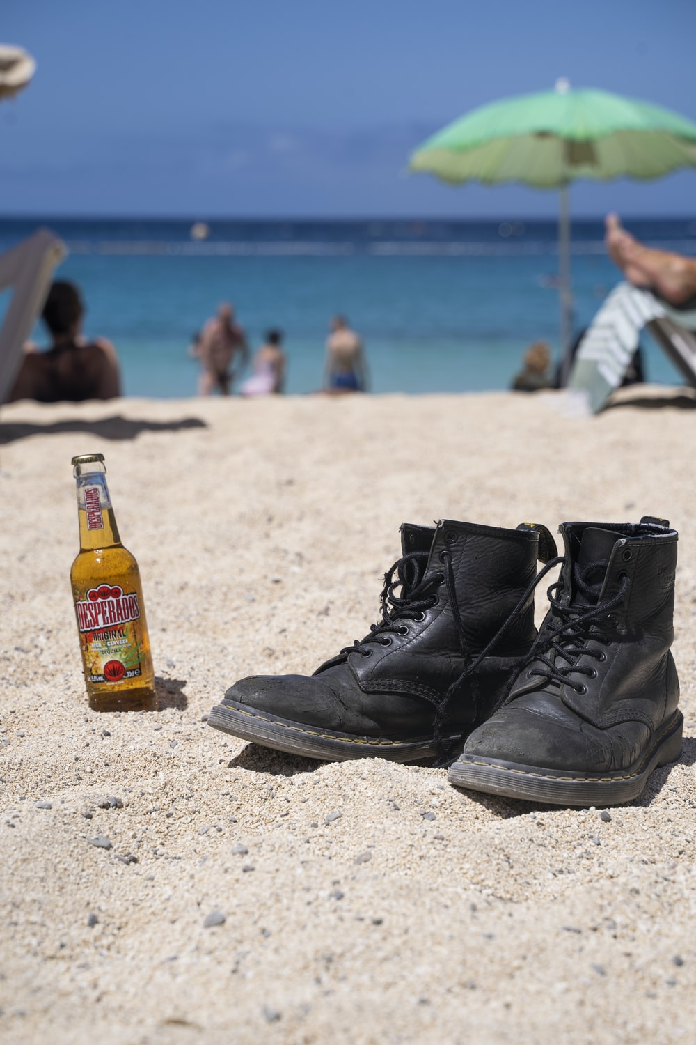 black leather boots on beach