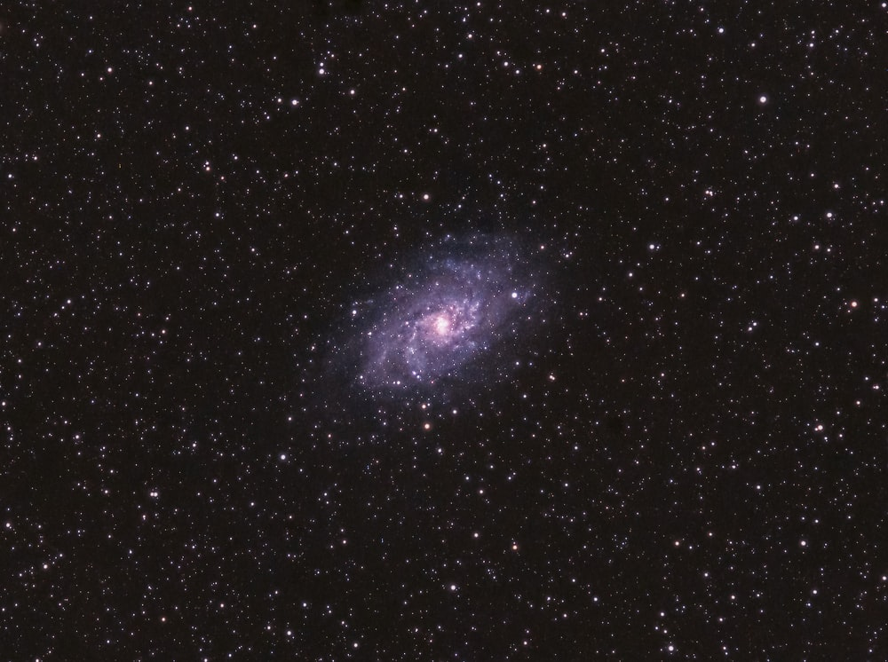 blue and black galaxy with stars