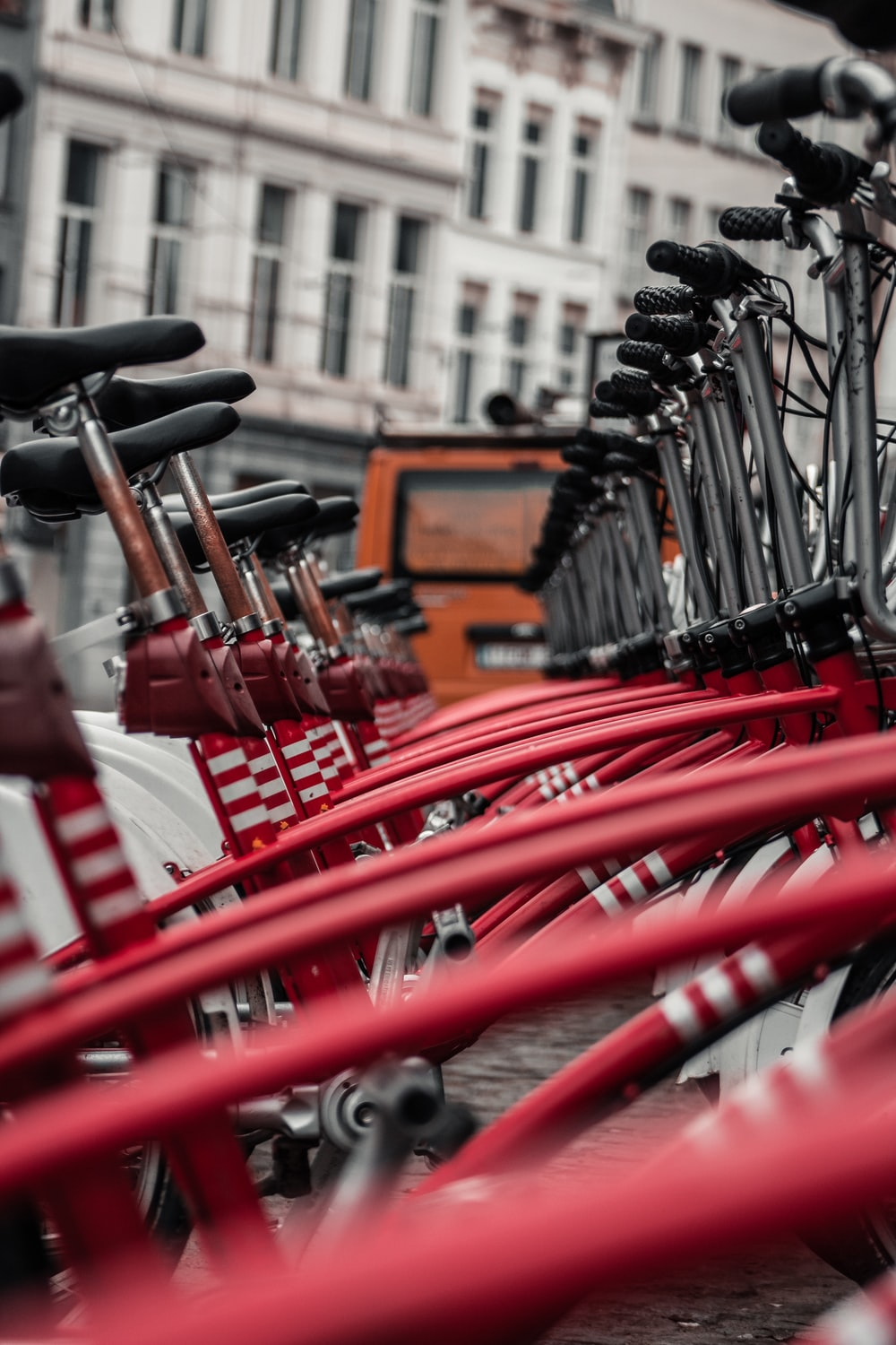 red bicycle parked on the street