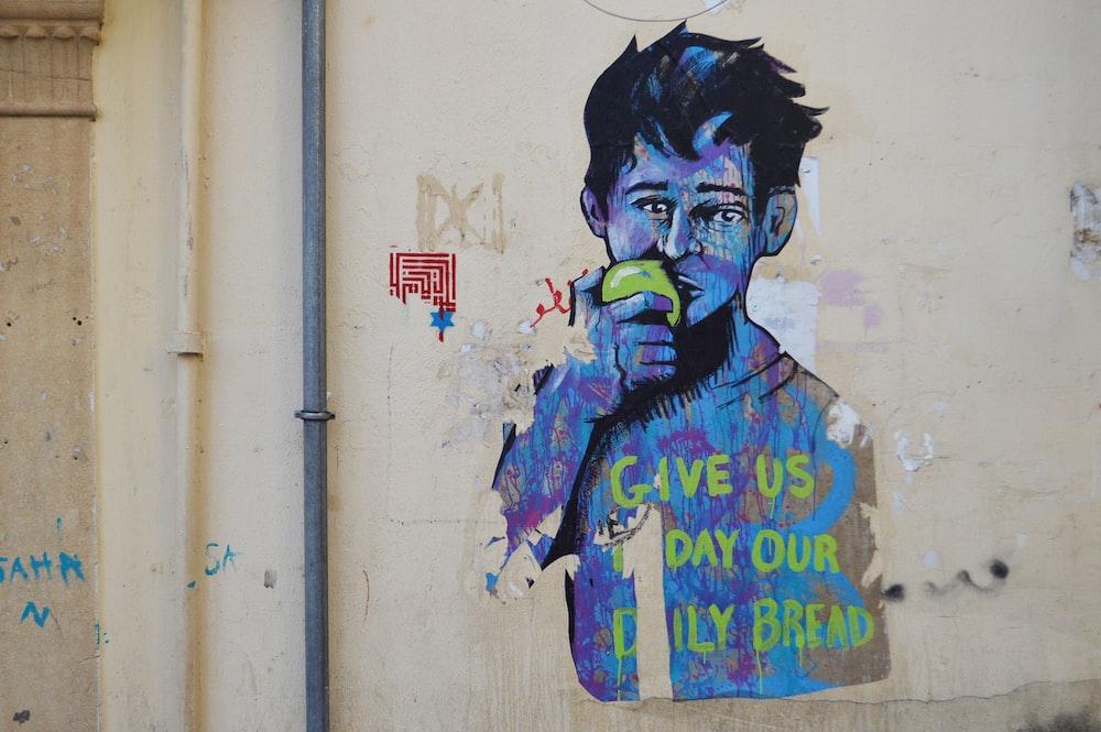 man in blue and green jacket graffiti