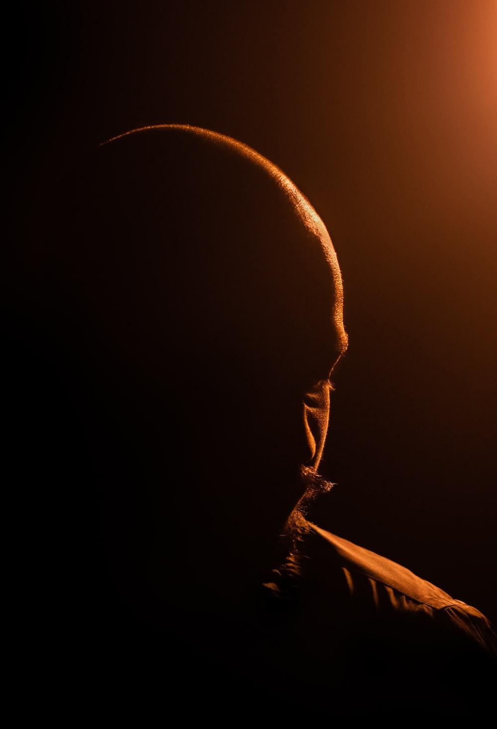 man in black hoodie looking up