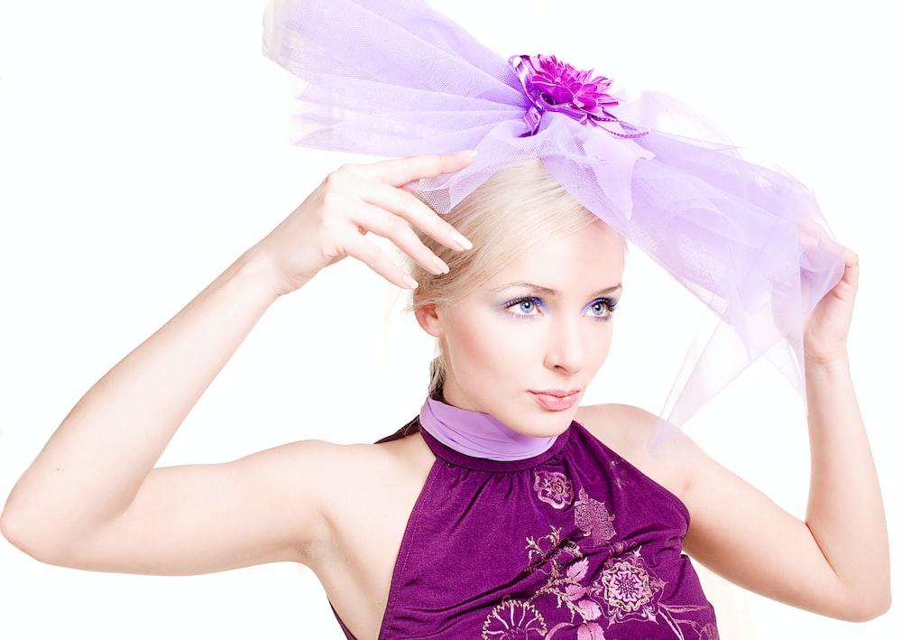woman in purple floral dress