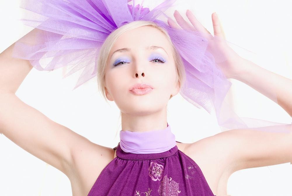 girl in purple dress with purple wings