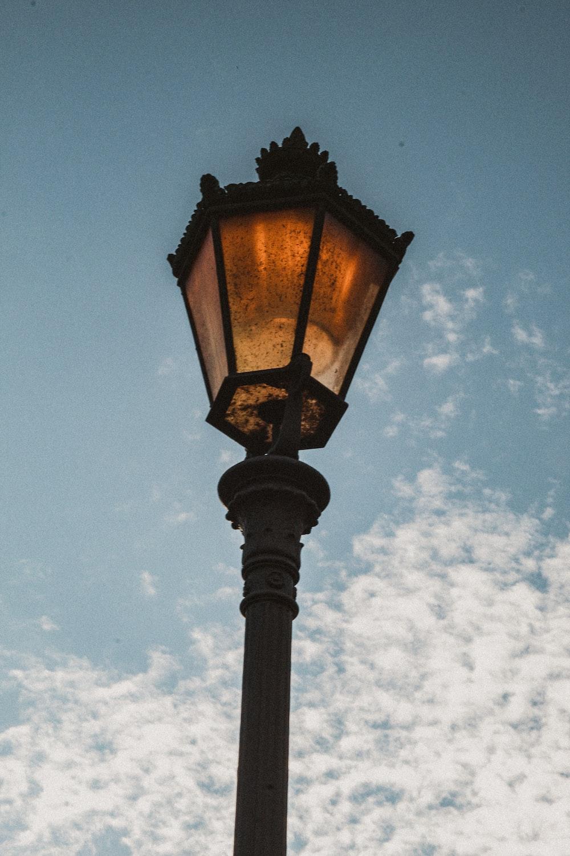 black street lamp under blue sky during daytime