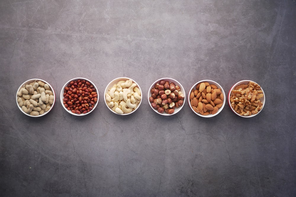 brown nuts on white ceramic bowls