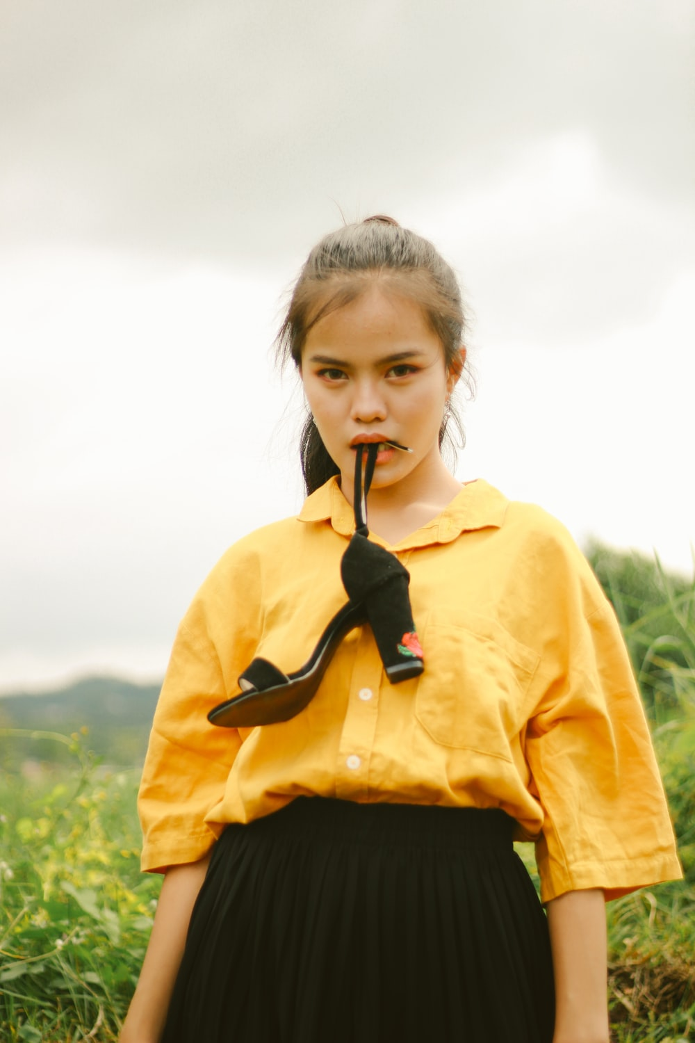 girl in yellow and black jacket