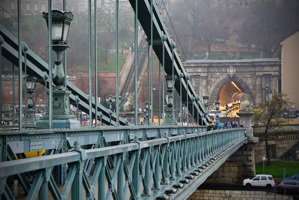 white metal bridge during daytime