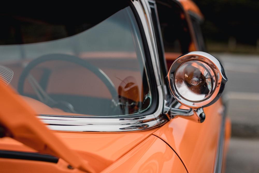 orange car with side mirror