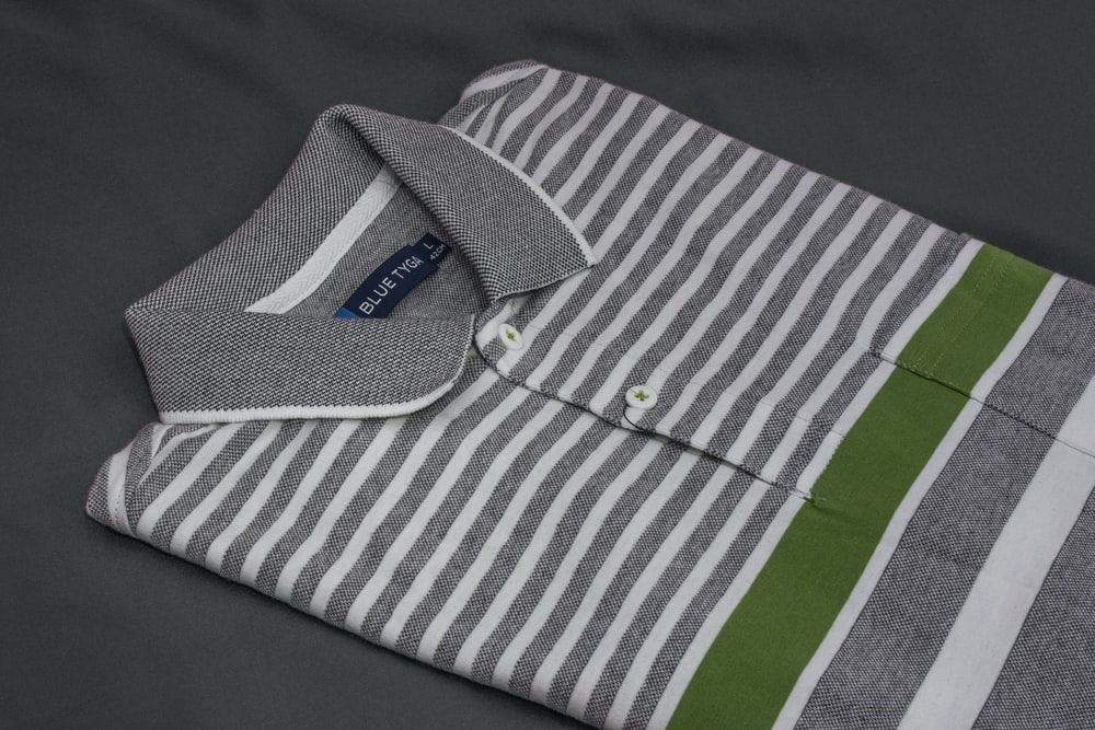 white and green striped polo shirt