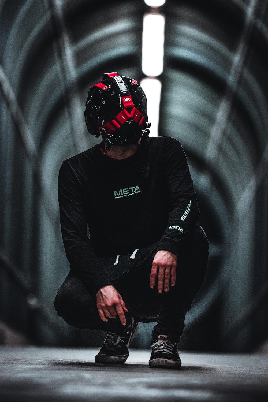 man in black jacket wearing red helmet