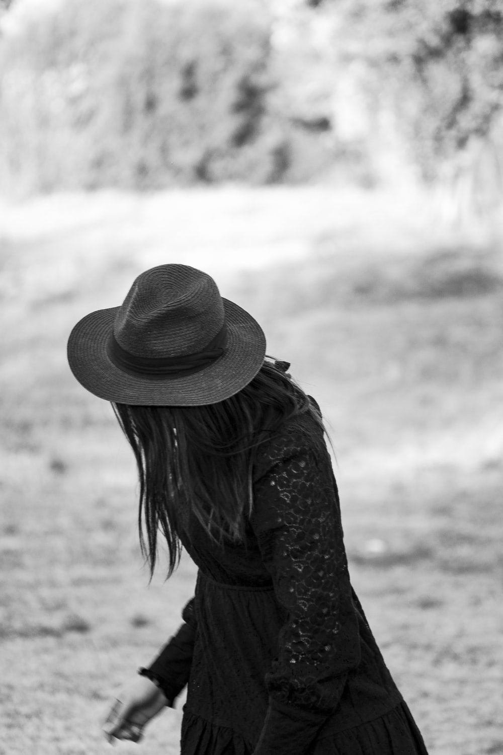 grayscale photo of woman wearing hat