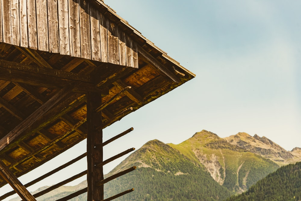 brown wooden house on top of mountain during daytime