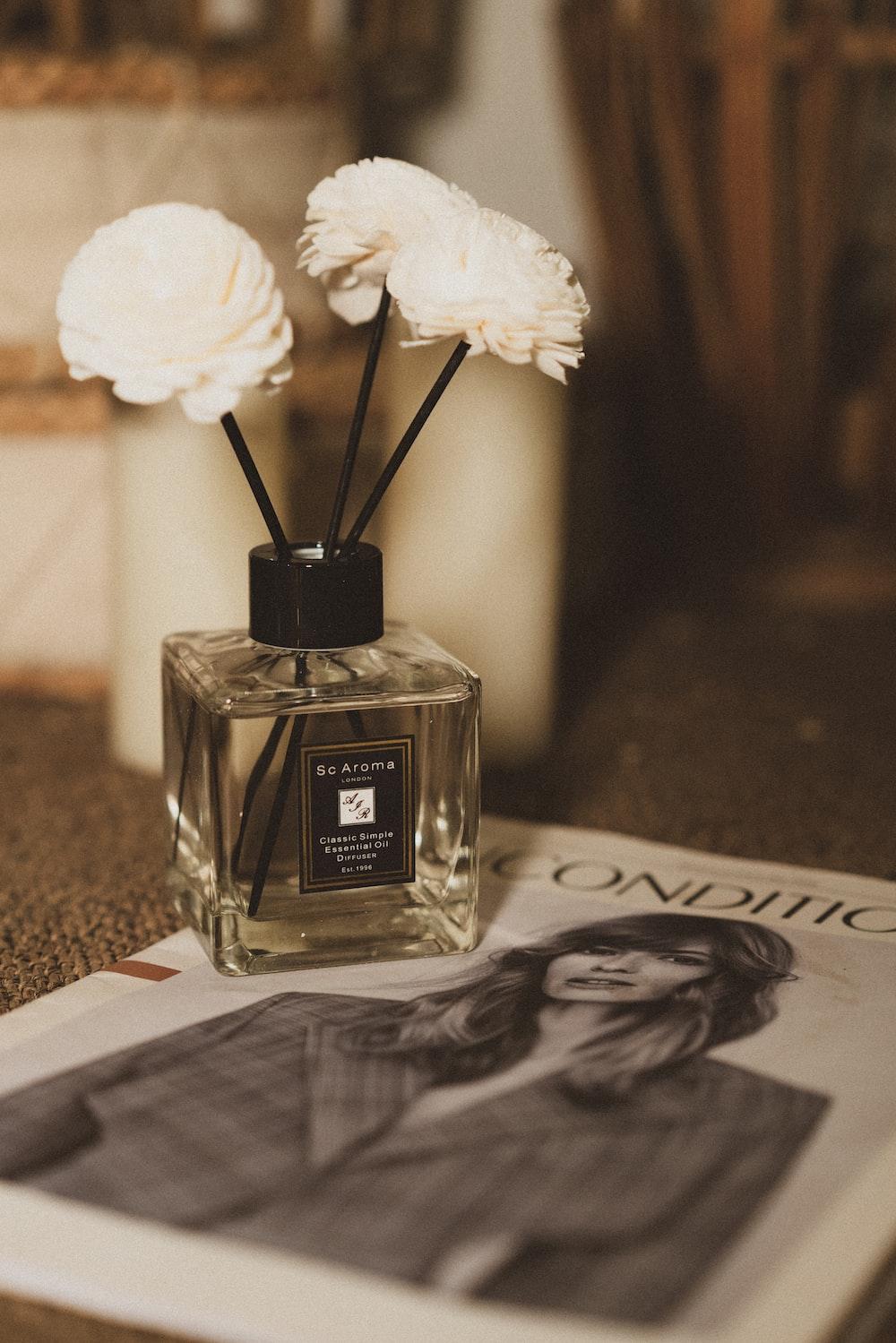 white rose on glass bottle