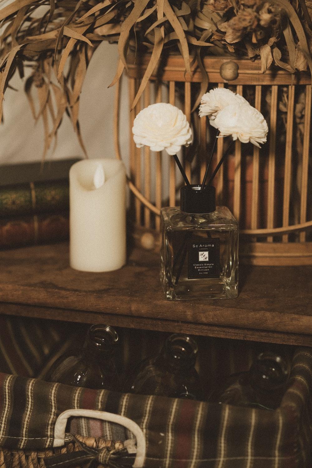 black glass perfume bottle on brown wooden shelf