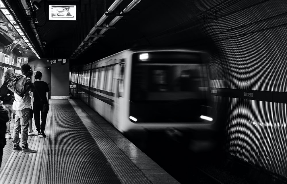 grayscale photo of train in train station