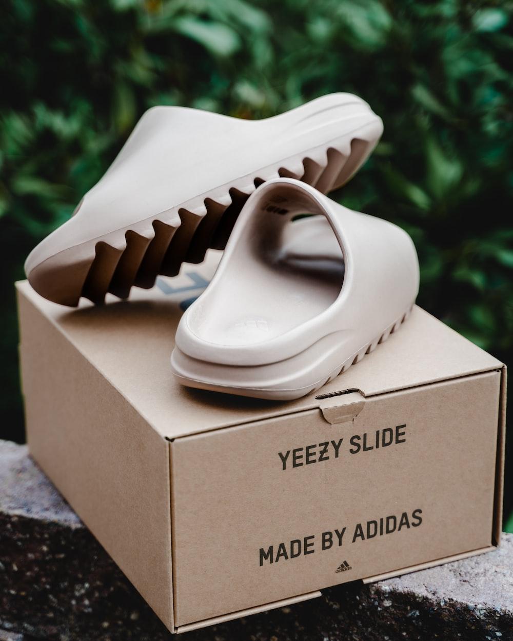 white ceramic shoe on brown cardboard box