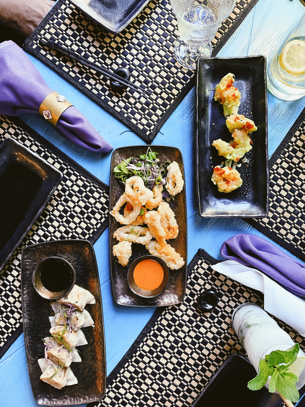 black ceramic tray with food on purple textile