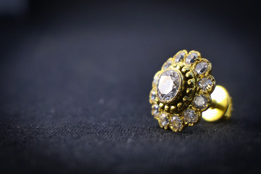 gold and diamond studded ring
