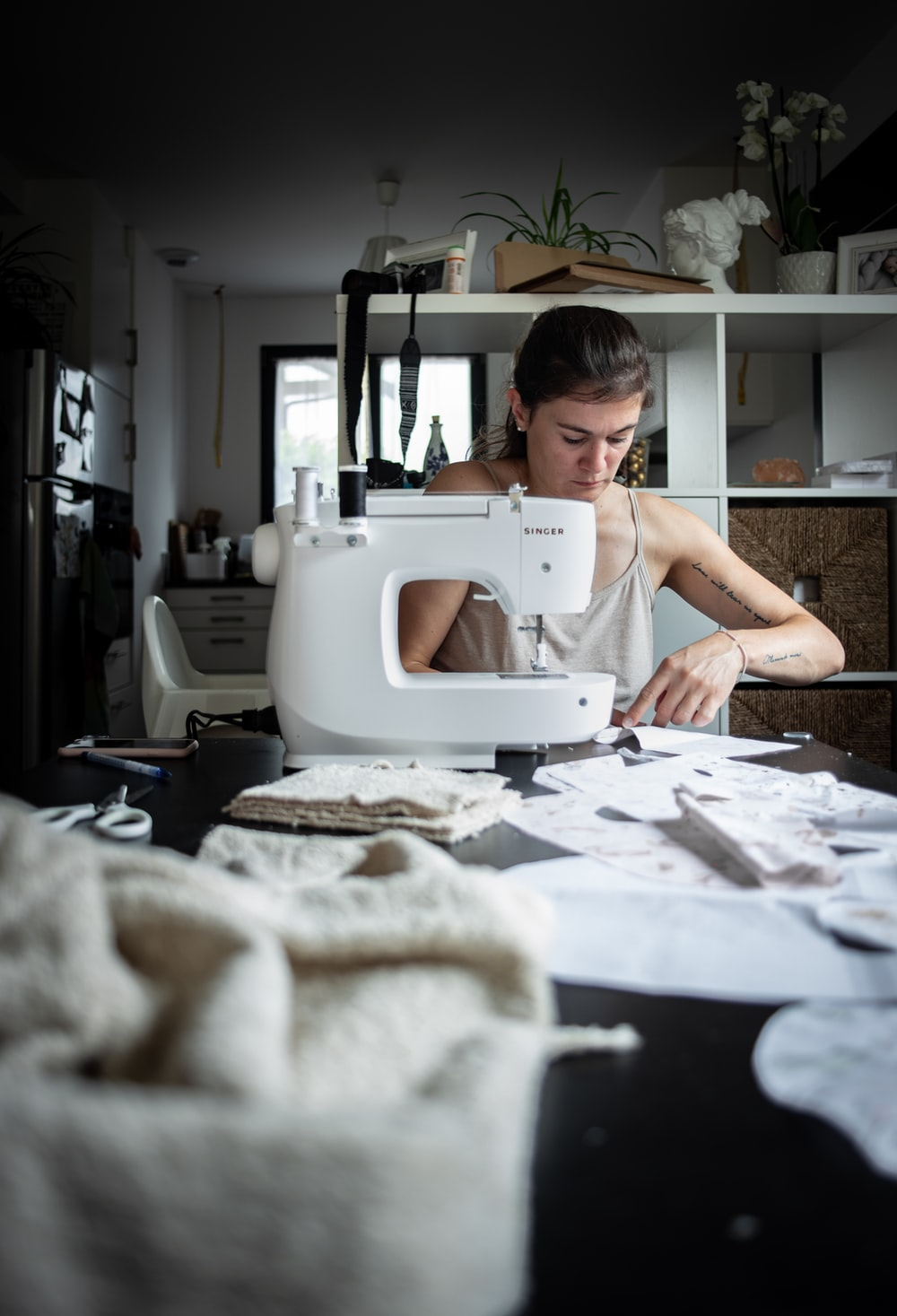 woman sewing at table