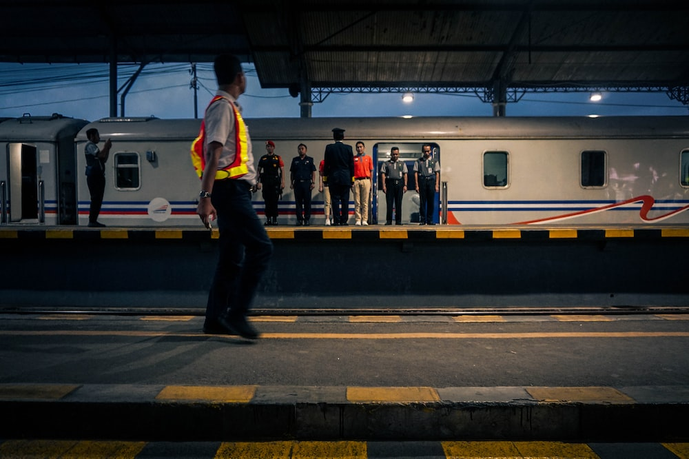 people standing on train station during daytime