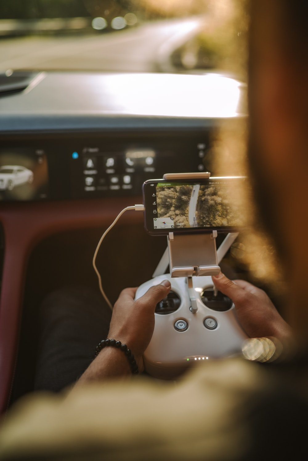 person holding white game controller