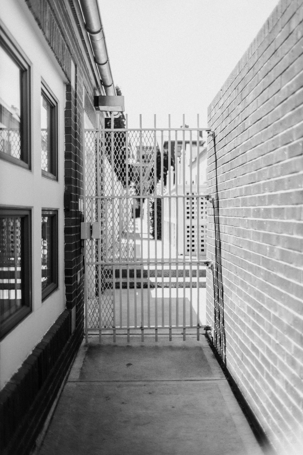 grayscale photo of metal gate