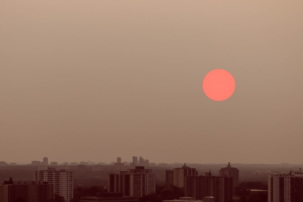 silhouette of city buildings during sunset