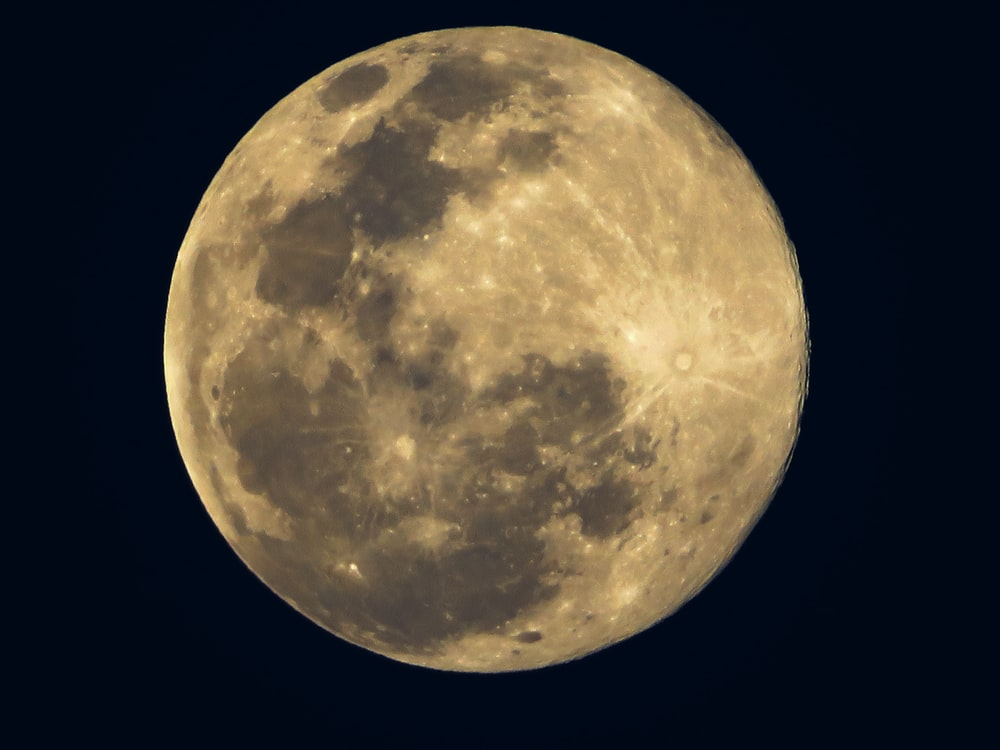 yellow moon with black background