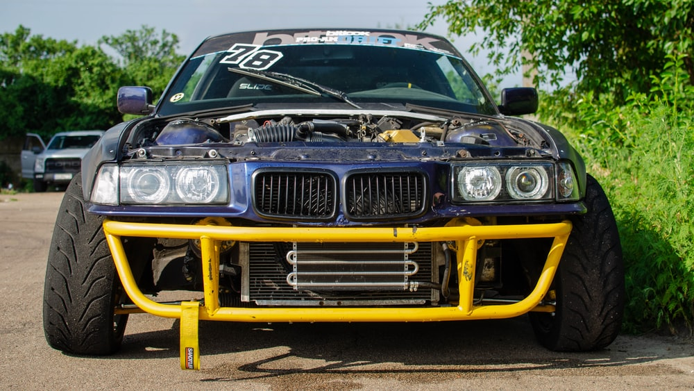 black and yellow bmw car