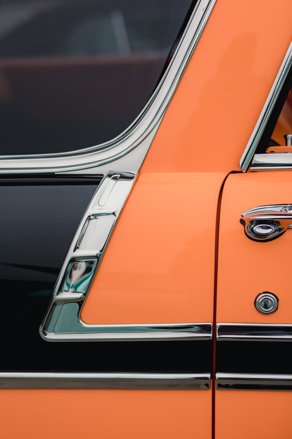 orange and silver car in a parking lot