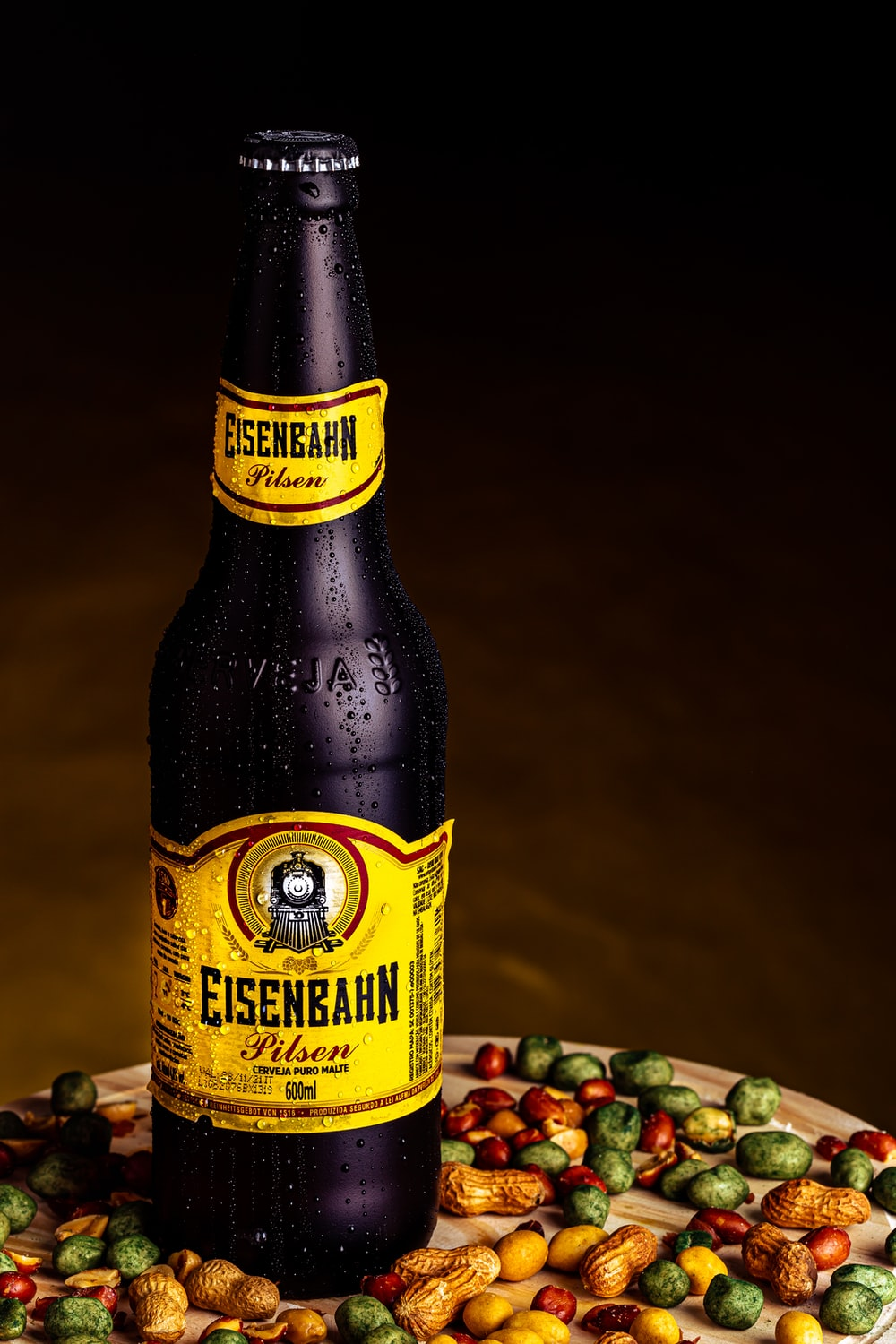 yellow labeled bottle on brown wooden table