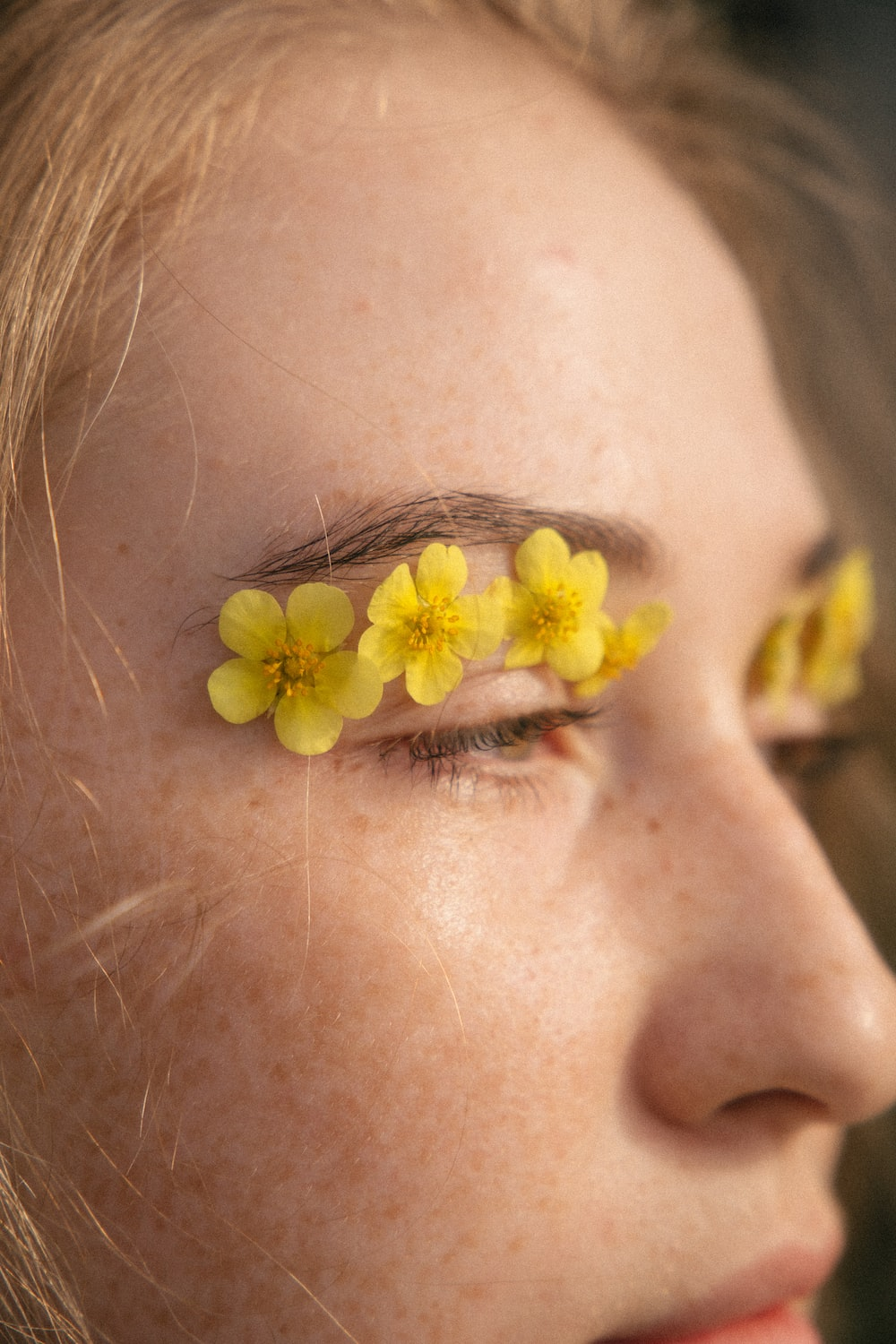yellow flower on persons ear